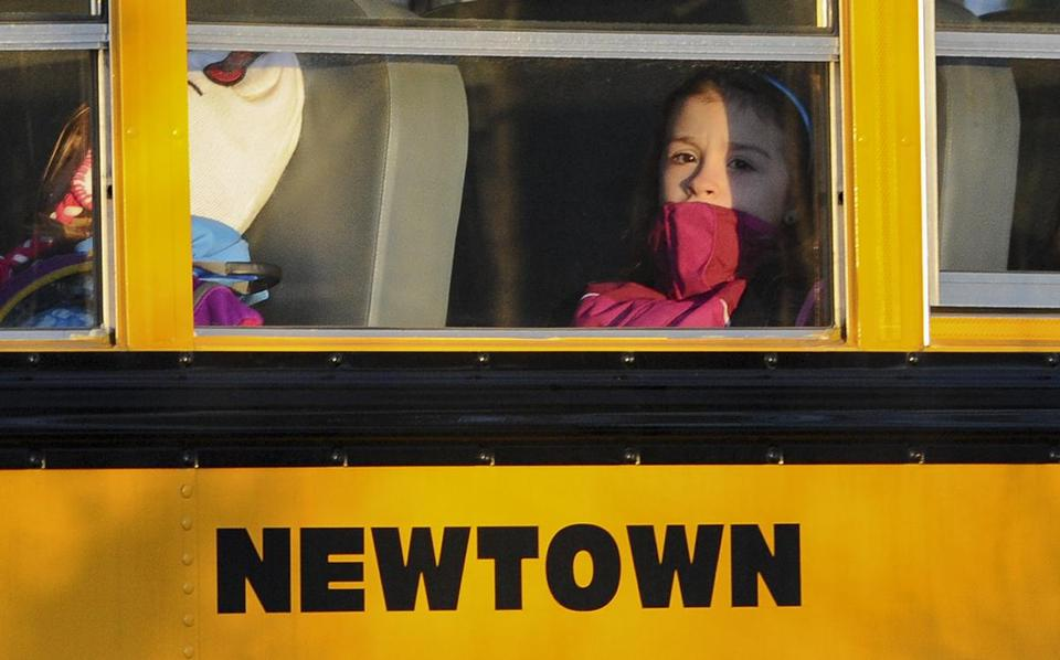 Students from Newtown, Conn., left the new Sandy Hook Elementary School on Thursday after the first day of classes in the neighboring town of Monroe.