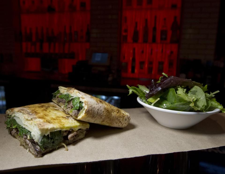 Charcoal Guido's steak panini includes caramelized onions and spinach and uses the same dough as the pizza.
