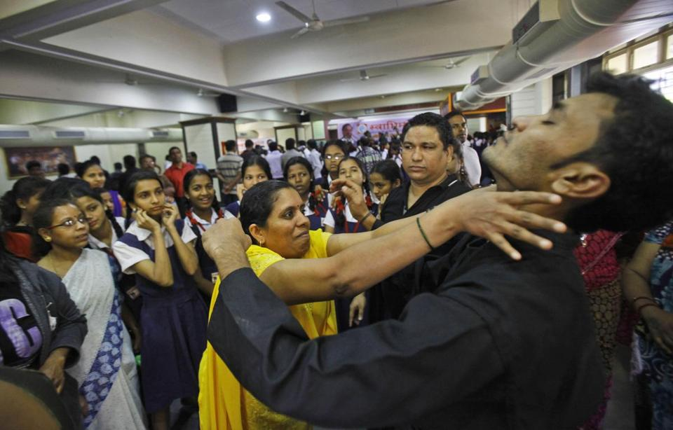 School children and staff members watched a self-defense training program at a school in Mumbai, India, on Friday, sparked by the gang rape of a woman on a bus in New Delhi.