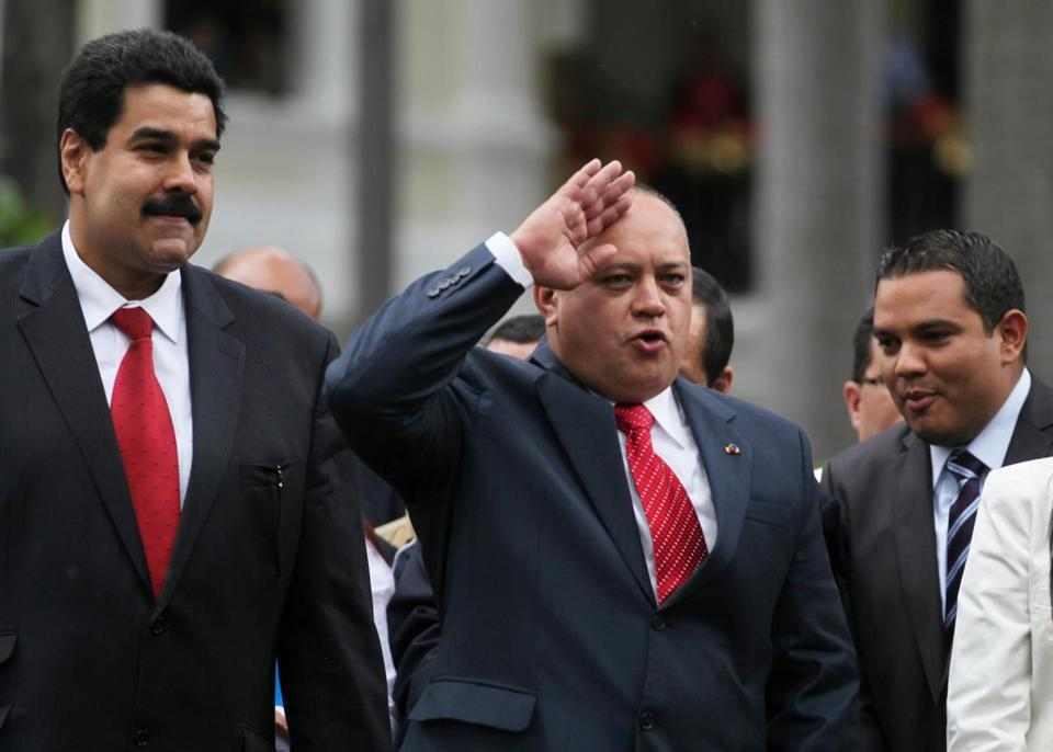 National Assembly President Diosdado Cabello, right, gestures to supporters of President Hugo Chavez as Vice President Nicolas Maduro, left, looks on after a session by lawmakers at the National Assembly in Caracas, Venezuela, Saturday, Jan. 5, 2013. Allies of President Hugo Chavez on Saturday chose to keep Diosdado as National Assembly president who is the next in line to step in as a caretaker leader in some circumstances. Just five days remain until Chavez's scheduled inauguration on Thursday, and government officials are suggesting the swearing-in could be delayed as the president fights a severe respiratory infection after cancer surgery in Cuba. (AP Photo/Fernando Llano)