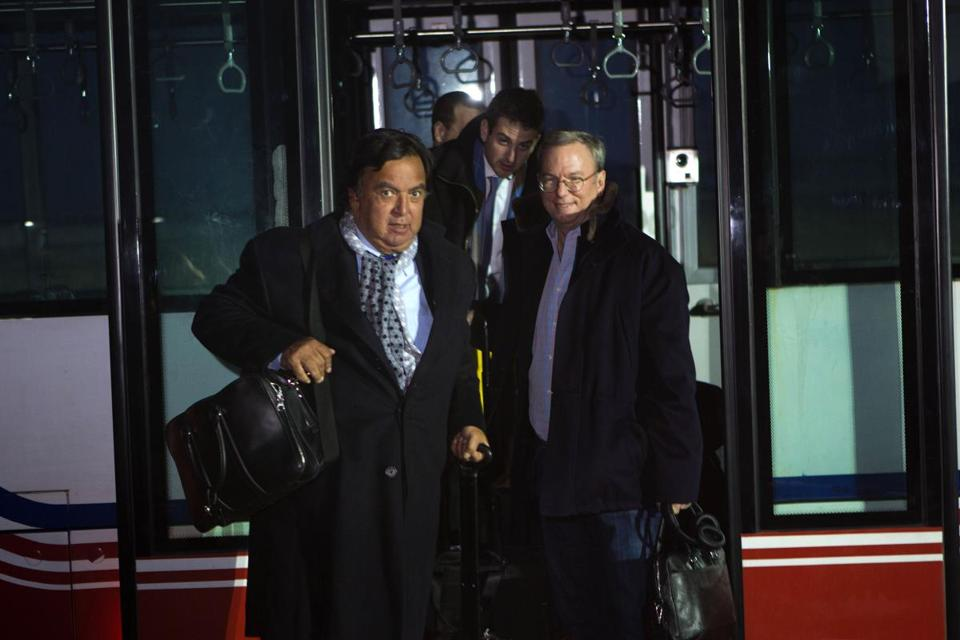 Former New Mexico Gov. Bill Richardson, left, and Executive Chairman of Google, Eric Schmidt, disembarked from an airport transfer bus after arriving at Pyongyang International Airport in Pyongyang, North Korea on Monday, Jan. 7.