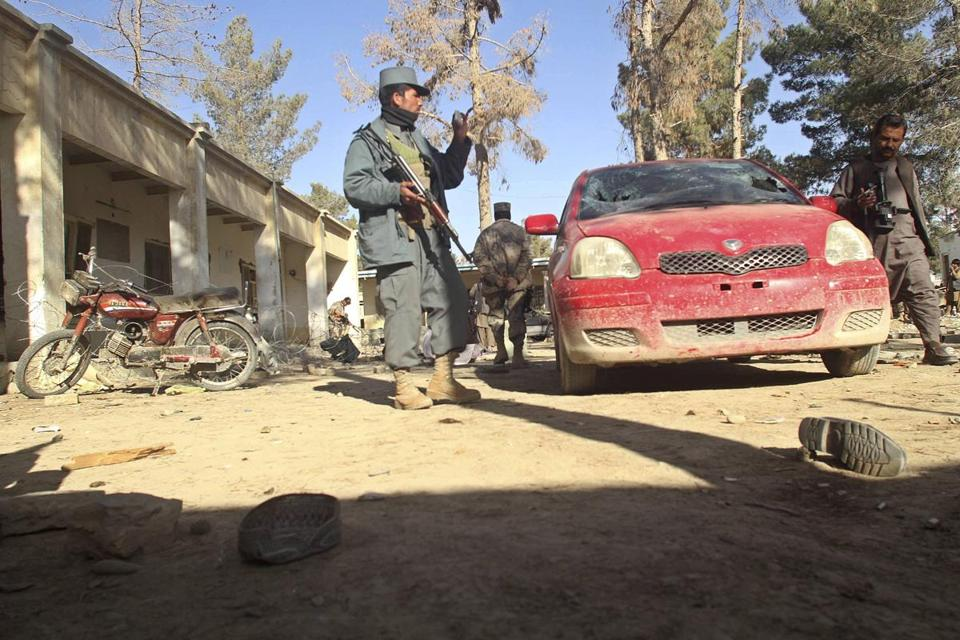 A policeman patrolled the site of a suicide attack in Spin Boldak District in Kandahar Province, Afghanistan.