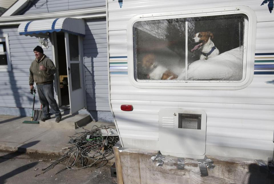 A family and its two dogs is living in a mobile home in the Broad Channel section of Queens while it repairs its house, which was damaged by Hurricane Sandy.