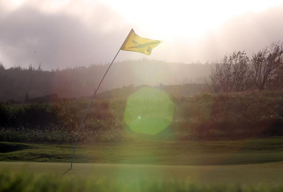The flagstick at No. 11 tells the story of another lost day at the Tournament of Champions.