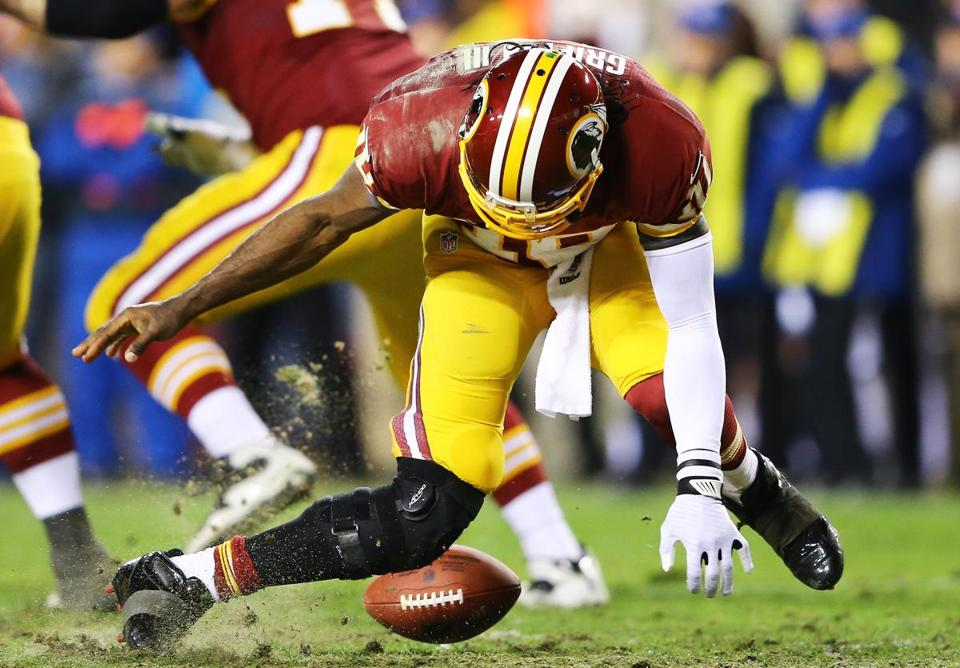 Robert Griffin III further injured his balky right knee on this bad snap late in the fourth quarter and didn't return.