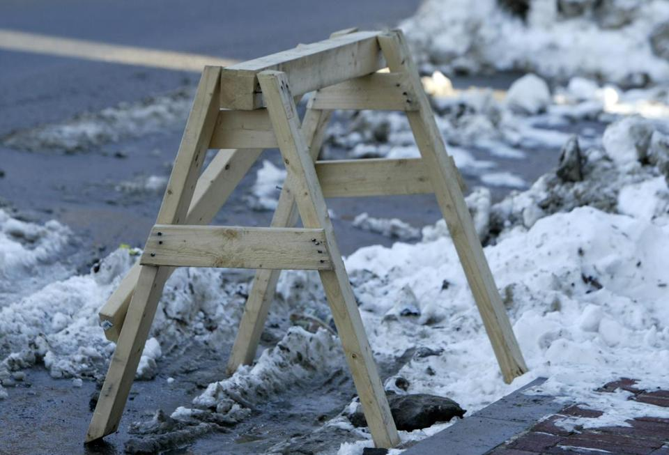 Items such as sawhorses are commonly used by shovelers in Boston to save parking spaces, but many wait days to remove those objects.