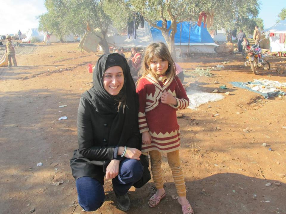 Christia Fotini with a Syrian girl in a camp for Internally Displaced Persons (IDPs) in Syria in the village of Atmeh.