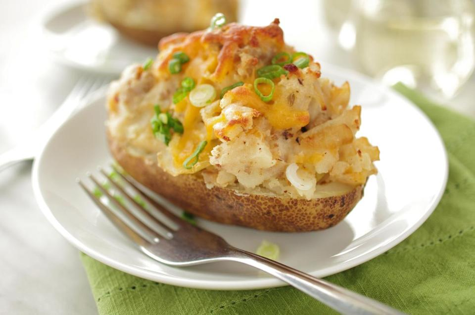 Sydney Oland's sausage-stuffed baked potatoes with smoky scallion mayonnaise.