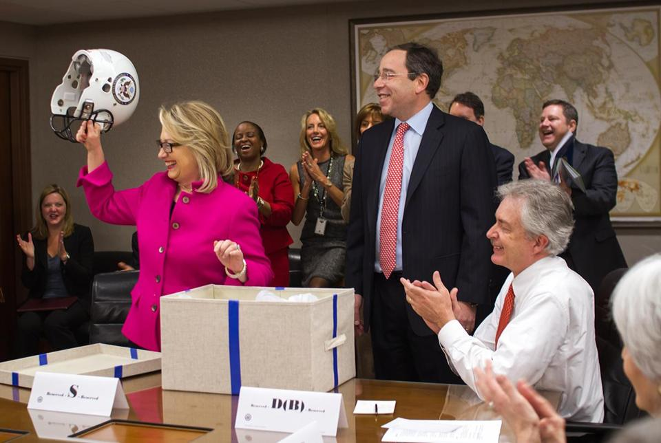 Deputy Secretary of State Thomas Nides presented Hillary Clinton with a gift: a regulation white Riddell football helmet emblazoned with the State Department seal.