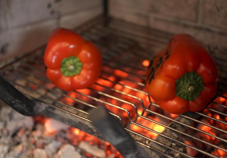 Red peppers are among the dishes that can be cooked over a glowing bed of embers in a fireplace.