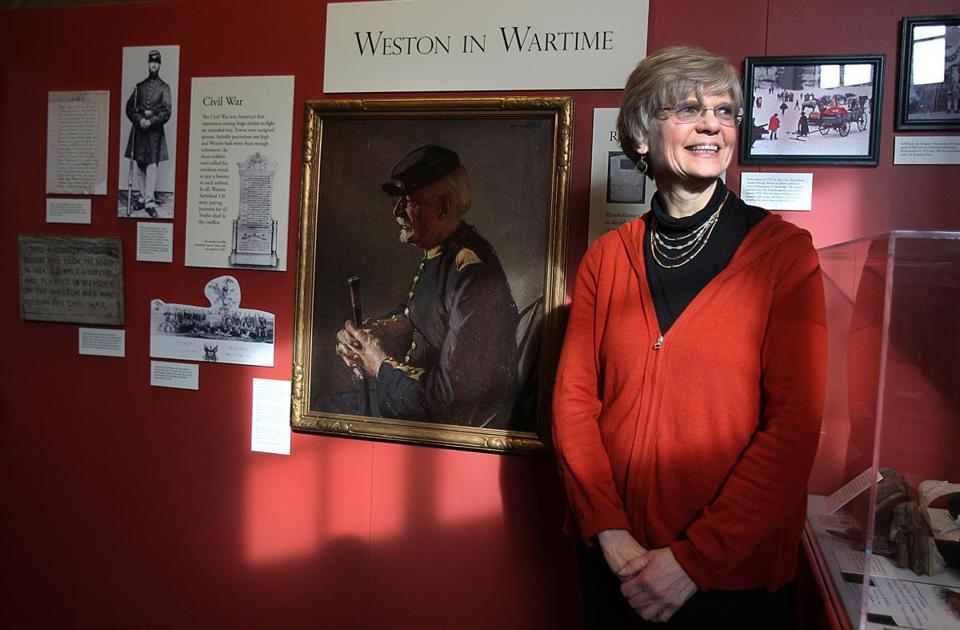 Weston Historical Society president Pam Fox oversees an exhibit on the town history.
