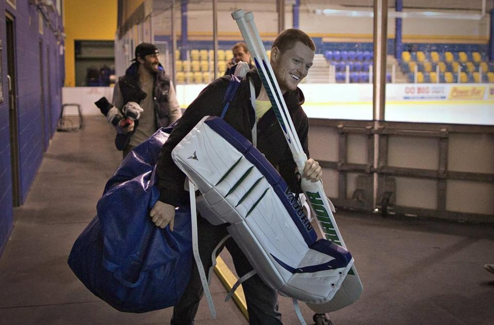 Vancouver's Cory Schneider, a former BC goalie, produces a smile on the way to practice.