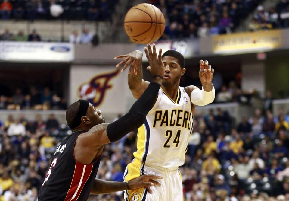Paul George gained the upper hand on Miami's LeBron James, scoring 29 points for the Pacers, who have won 11 of 13 games.