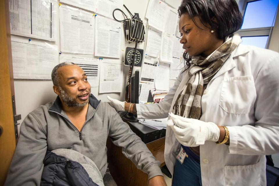 Lincell Jackson of Dorchester received the flu vaccine from registered nurse Denise Duvinston at the Upham's Corner Health Center Thursday.