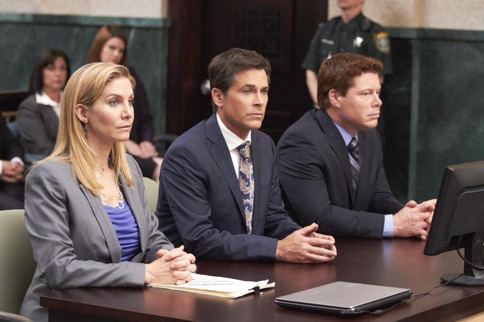 "From left: Elizabeth Mitchell, Rob Lowe, and David Richmond-Peck in Lifetime's ""Prosecuting Casey Anthony."""