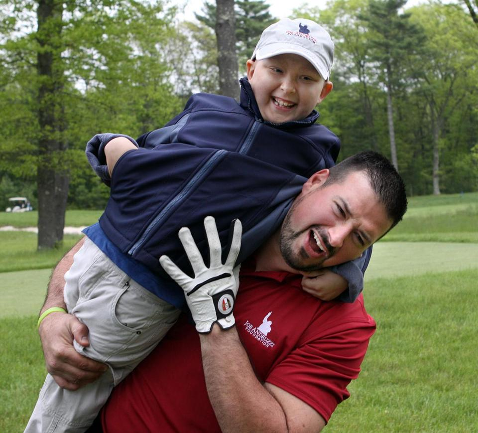 Andruzzi with 6 year-old Ethan Bairos in 2011. Andruzzi started visiting cancer patients as a Patriots player and stuck around after the cameras stopped rolling. .