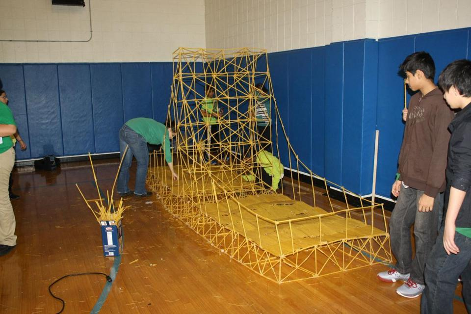 PASTA PROGRESS — Students at the Pioneer Charter School of Science in Everett designed and built bridges out of spaghetti. The students weighed their creations and administered destructive testing to determine the sturdiness of each bridge.