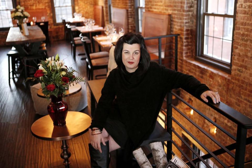 Ceia owner Nancy Batista-Caswell on the third floor of her restaurant.