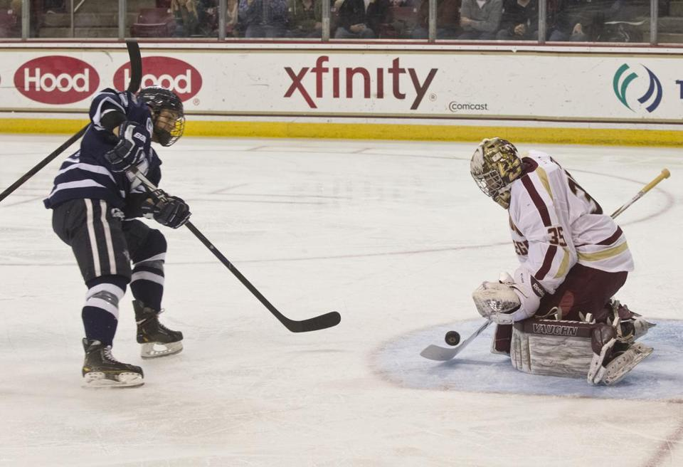 BC goaltender Parker Milner denies UNH's Dan Correale for one of his 31 saves.