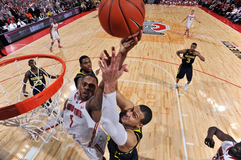 Ohio State's Deshaun Thomas (left) has the upper hand in this battle above the rim with Michigan's Jordan Morgan.