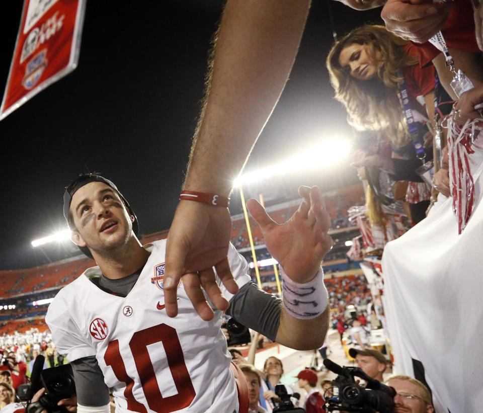 Katherine Webb, (right) the girlfriend of Alabama quarterback AJ McCarron, watched the QB celebrate after winning the BCS title game.