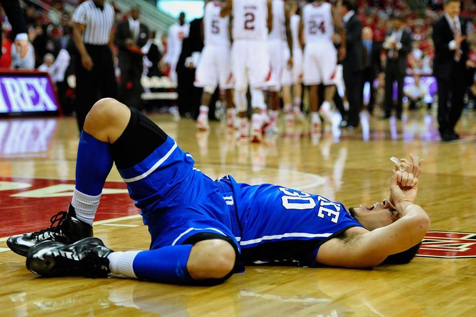 Duke sensation Seth Curry rolls on the floor after injuring his ankle late in the Blue Devils' loss to N.C. State.