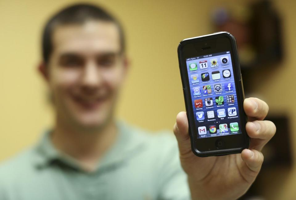 Stephen Stetelman, a real estate agent and iPhone user, has his loyalties divided between Apple and Google.