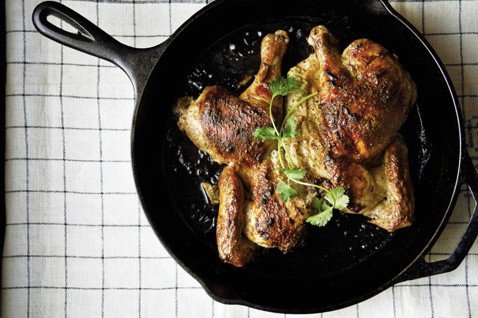 Butterflied roast chicken with cardamom and yogurt.