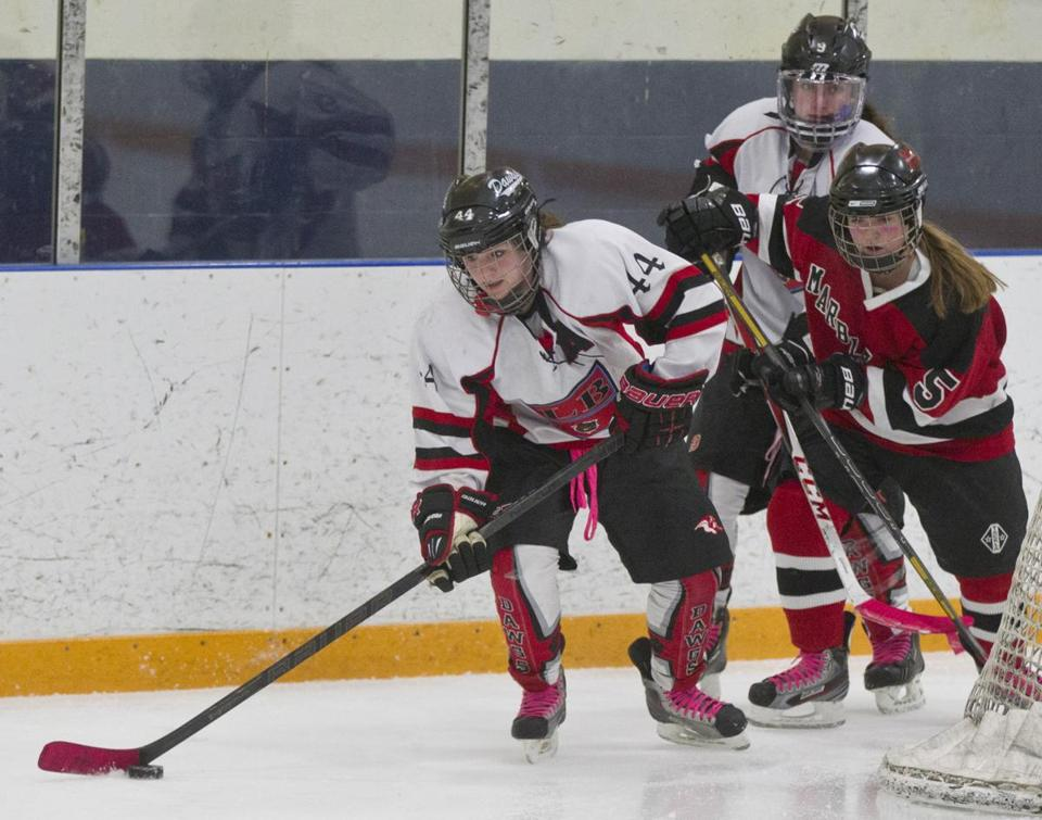 Winthrop's Caroline MacKinnon (44) skates in front of Marblehead's Meg Gray during third-period game action.