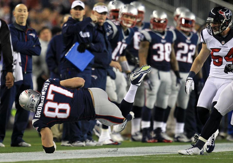 Rob Gronkowski re-broke his left arm  on this play against the Texans in the playoffs in January. (Barry Chin/Globe Staff)