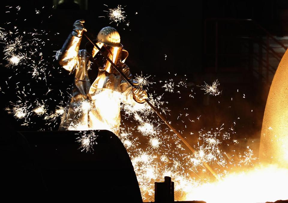 Germany's economy contracted 0.5 percent in 2012's fourth quarter. Above, a steelworker in Duisburg in December.