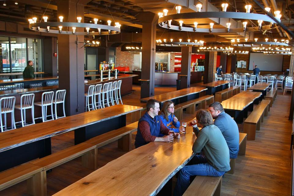 The Harpoon Brewery has undergone a renovation to better accommodate visitors. Employees (above) took a break in the new beer hall.