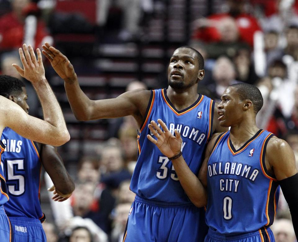 Kevin Durant (center) scored 27 of his 41 points in the second half of the Thunder's win over the Suns.