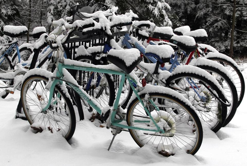 Snow blanketed bikes at Wellesley College Wednesday as a storm dropped 3 to 5 inches of the white stuff on the area.