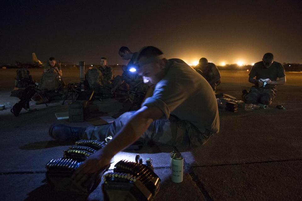 French soldiers readied ammunition Sunday at a military airbase in Mali, where France has pledged a force of up to 2,500 to battle Islamist fighters pressing from the north.