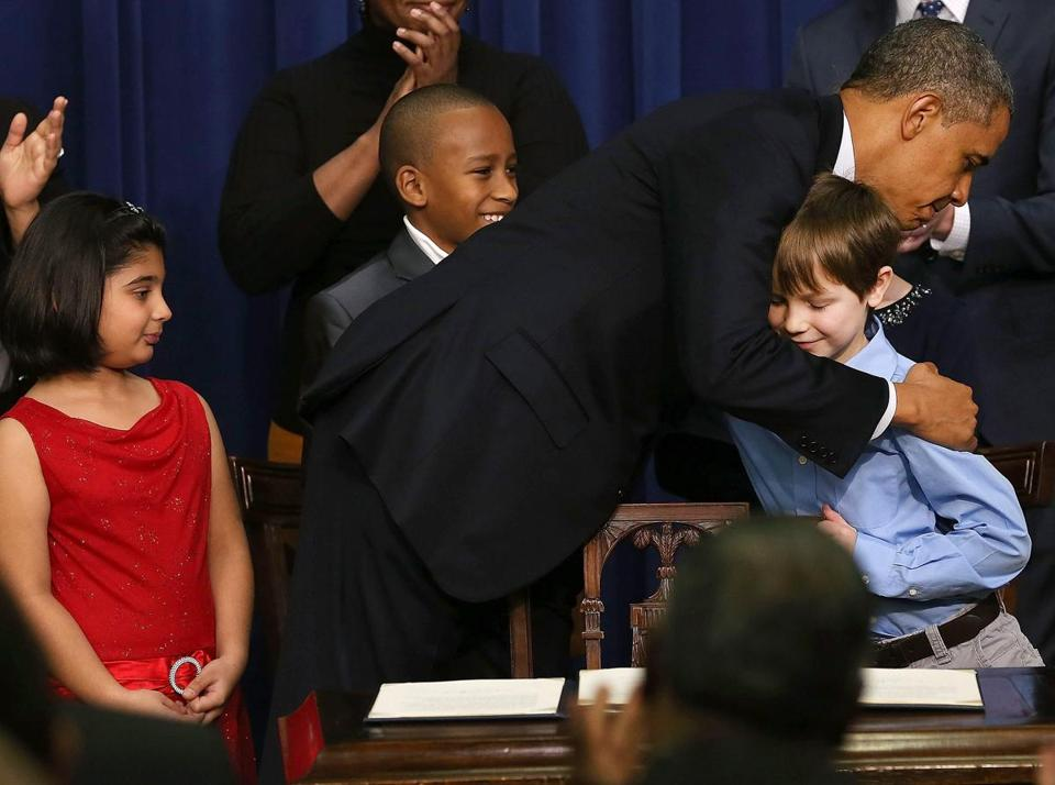 President Obama hugged one of the four children who appeared with him as he unveiled his proposals in Washington.