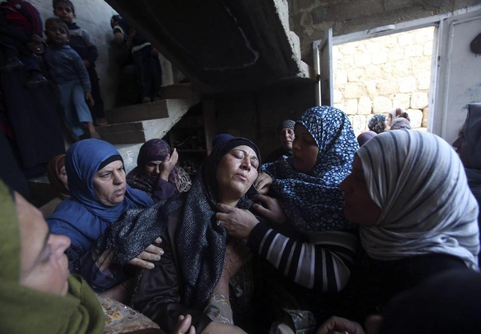 The mother of Samir Awad, 16, mourned during his funeral Tuesday in Budrus, not far from Ramallah.