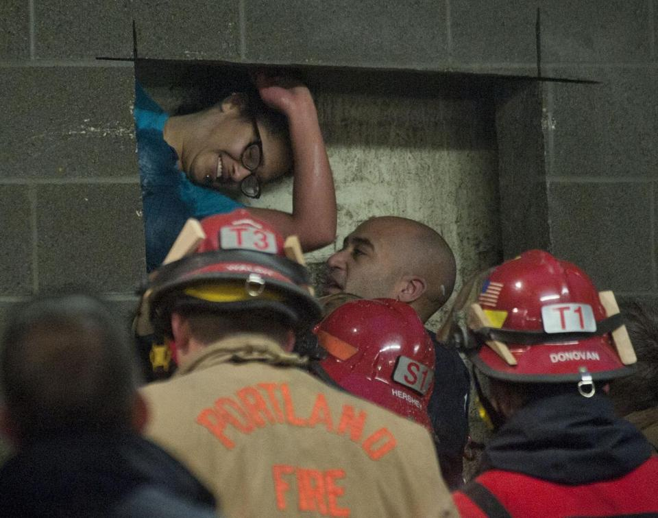 The Portland Fire Department's Urban Search and Rescue unit had been trained for similar situations. They made cuts and used a soapy lubricant to execute the rescue.
