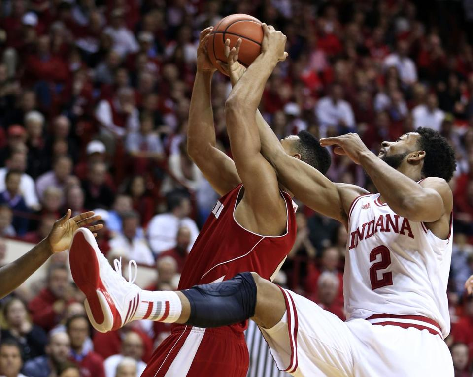Wisconsin forward Ryan Evans is fouled by Indiana's Christian Watford during the first half of the game.