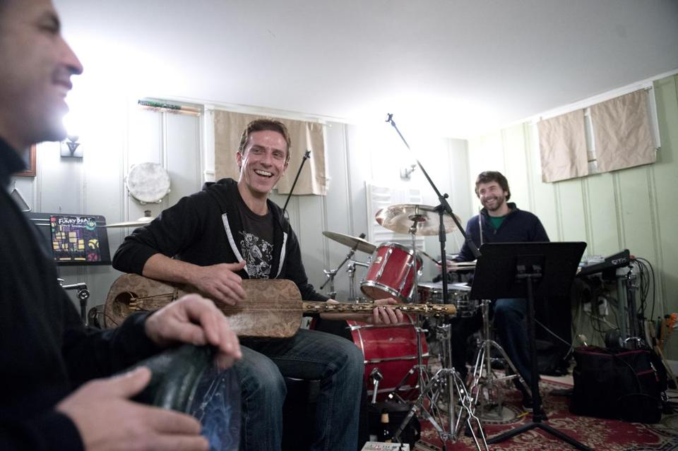 Club D'elf members (from left) Boujemaa Razgui, Mike Rivard, and Dean Johnston rehearsing recently in Milton.