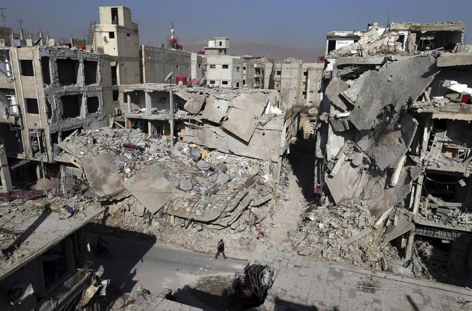 Strikes by Syria's air force destroyed buildings in the Duma neighborhood of Damascus in the ongoing violence there.