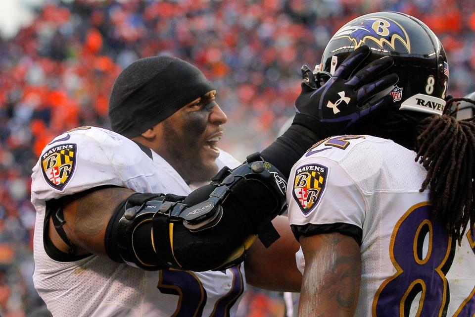 Ray Lewis, who missed time to an injury this season, and Torrey Smith, who lost his brother in September, celebrated Smith's touchdown on Saturday in Denver.