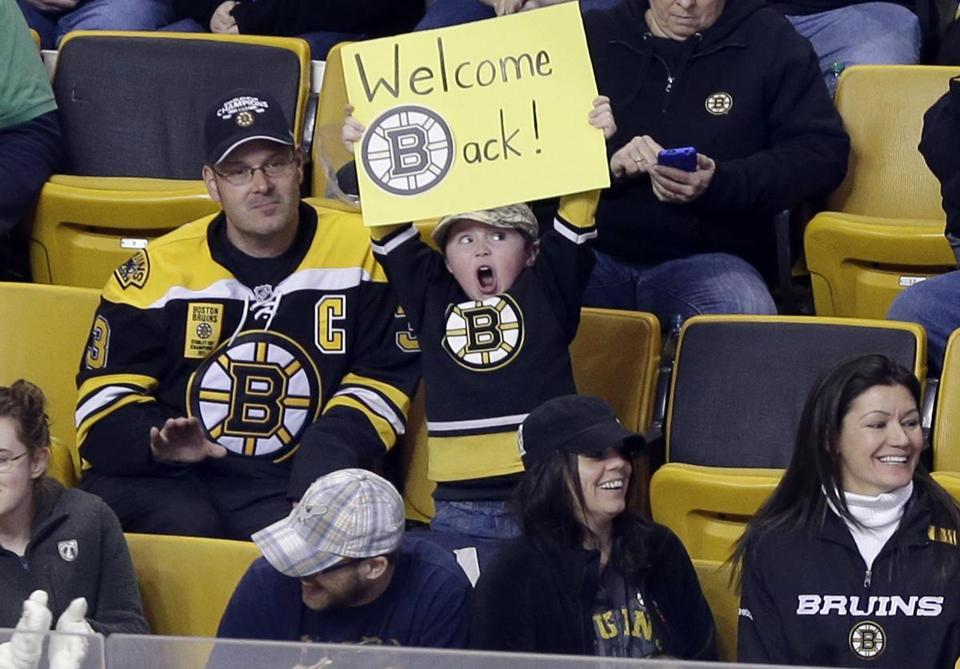Jake Carr, 5, holds up a sign during a scrimmage between the Boston Bruins and the Providence Bruins at TD Garden Tuesday.