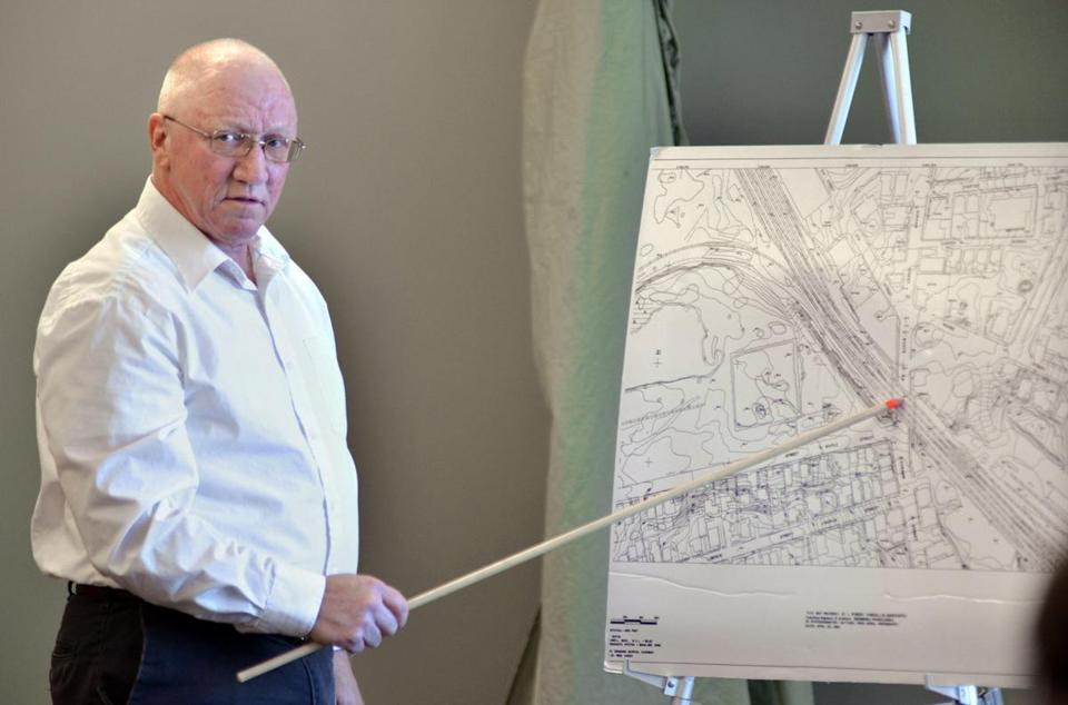 WOBURN - Edward A. Brown holds a map of the section of Lowell where 15-year-old John McCabe was murdered in 1969.