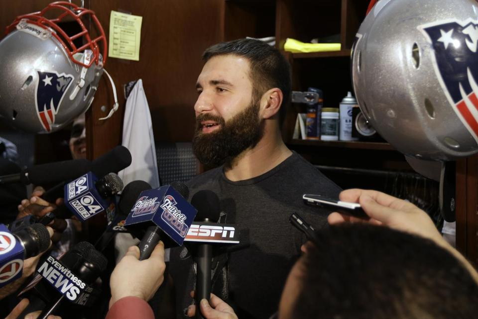 Rob Ninkovich, shown at his locker, has an uncanny knack for the big play, just like another No. 50 from the Patriots' glory days, Mike Vrabel.