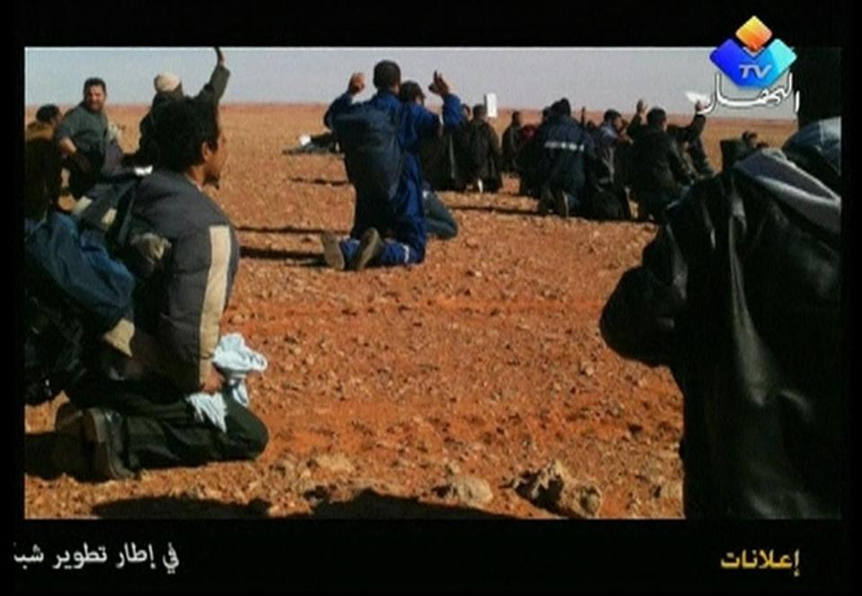 Hostages are seen with their hands in the air in this still image taken from video footage on Jan. 16 or Jan. 17, 2013.