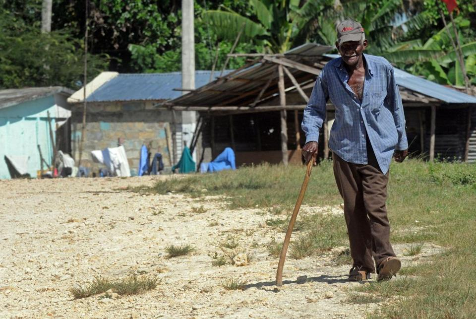 Julien Henrique, 92, strolled through a sugar workers community in San Pedro de Macoris, Dominican Republic. The Haitian native does not have official documents.