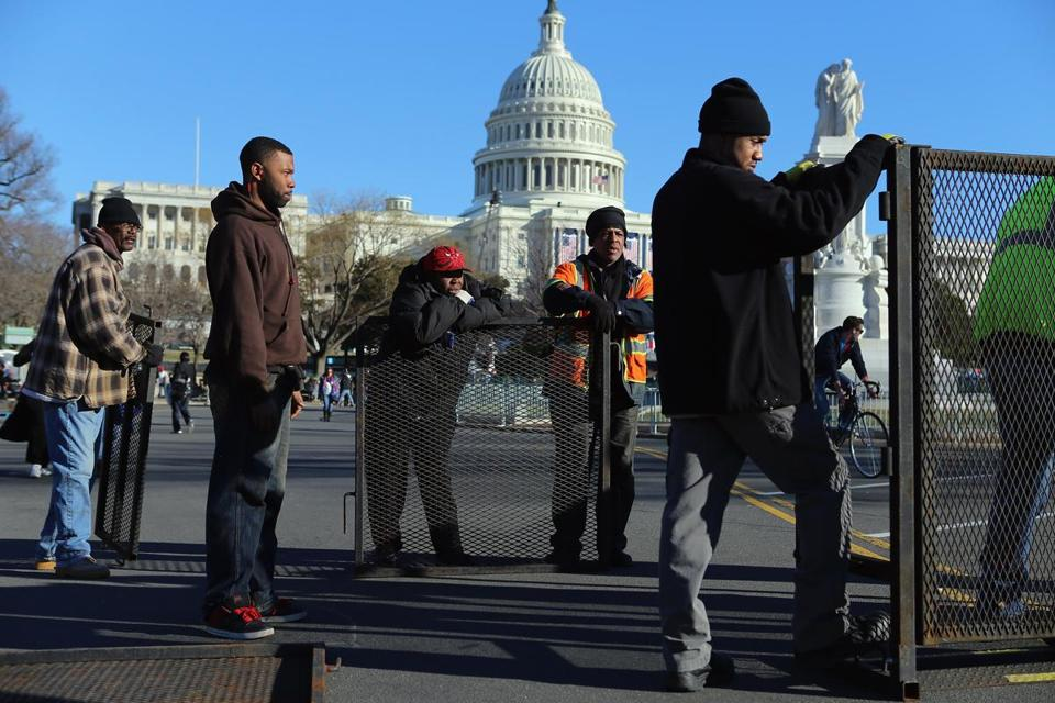 A crew put up a security fence near the US Capitol for the inauguration festivities.