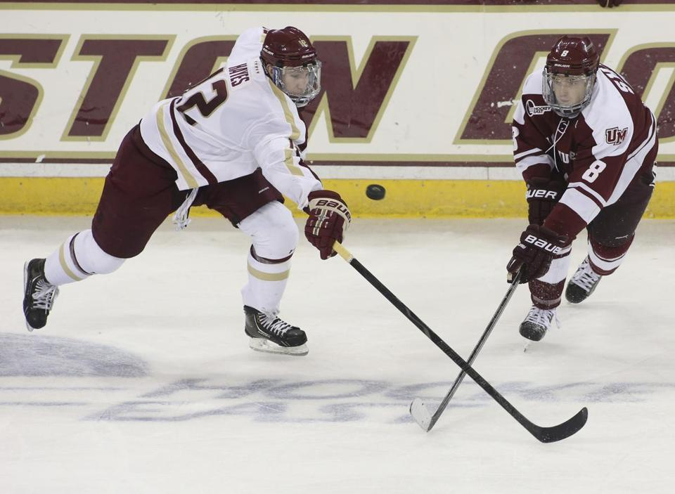 BC's Kevin Hayes (left) crosses sticks with Colin Shea during the third period.
