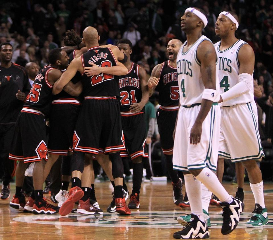 Celtics Jason Terry and Paul Pierce walk off the court as the Bulls celebrate their victory in the final seconds of overtime at TD Garden.